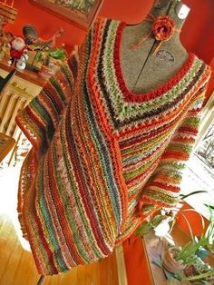 """Just a pic for inspiration.  Looks to be two rectangles (knitted here, but could crochet), joined short to long edge on front and back, then a """"neckline"""" added by working rows with decreases where the rectangles are joined."""