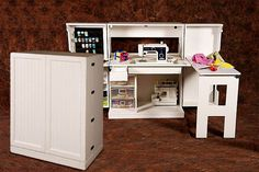 I must have this...  SewingBox. Small cabinet unfolds into an awesome sewing station!