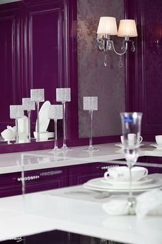 I'm undecided on whether or not I like this.  It's different for a kitchen, but I love the plum color with the stainless steel and white accents... could be really elegant with a more deeper purple.