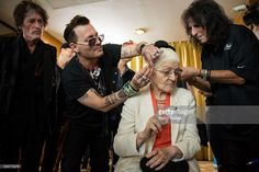 Joe Perry, Johnny Depp and Alice Cooper work with a patient of the Starkey Hearing Foundation at Four Season Hotel Ritz Lisbon on May 27, 2016 in Lisbon, Portugal.