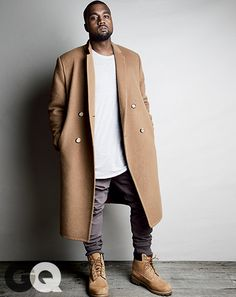 "Kanye West Spills His Style Secrets for God-Level Fashion | ""Skinny pants are rock 'n' roll. And big coats are really hip-hop. I'm looking for 50 percent rock 'n' roll, 50 percent hip-hop, 50 percent genius,"" Coat, $4,995 by Calvin Klein Collection T-shirt, $290 by Balmain pants $195 by Michael Kors Boots $190 by Timberland"