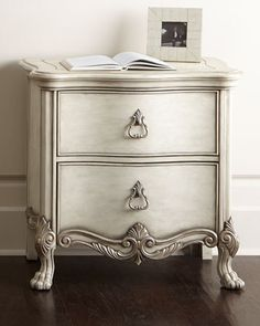 """Nightstand made of maple. Cast carvings. Antique-silver highlights. Two drawers; top drawer with felt-lined bottom. 30""""W x 18""""D x 30""""T. Imported. Boxed weight, approximately 56 lbs."""