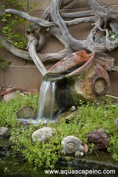 fountains in the garden, outdoor living, ponds water features, A rustic urn flows beneath dramatic driftwood art