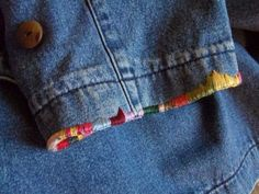 Beautiful over-sewing to hide frayed cuffs. Could also use on jeans - visible mending