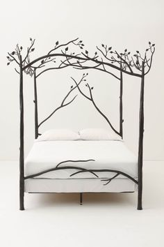 Forest Canopy Bed   Slumber in an enchanted wood and dream of ancient incantations as hand-forged iron branches cast their leafy net high above your head.  $5,298