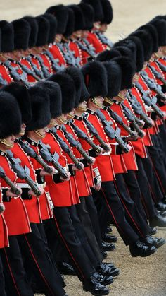 General view of members of the Queen's Guard marching during the Trooping Of The Colour at Horse Guards Parade on June 16, 2012 in London, England.
