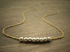 Items similar to Eight wish/ Sterling silver and Gold necklace/petite/ dainty necklace/ simple minimalist necklace/ Wish necklace/ Bridesmaid gift idea. on Etsy Minimalist Jewelry, Charms, Gold Necklace, Sterling Silver, Trending Outfits, Unique Jewelry, Bracelets, Handmade Gifts, Etsy