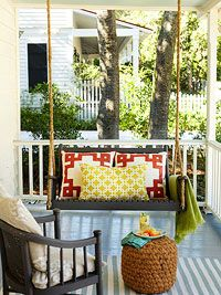 Front Porch Ideas: Add comfy seating (swing seat with cute pillows + cute chair); paint the floor a color, surround with plant life. #bhg
