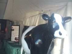 PT 152 JULY 2014 CANYON COUNTY FAIR. A PLASTIC COW AT THE AGRICULTURE BUILDING.