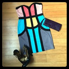 Strapless Colorblock Mini Dress A truly unique and modern take on a fitted tube dress! The color blocking and black lines are cut with the curves of the body, which accentuates and flatters your figure. The dress does run a little snug; I'm 5'7 and it's pretty short on me. Definitely a statement piece! Excellent condition. ModCloth Dresses Strapless