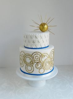This looks like a Dr Who wedding cake to me. I wonder if the writing around the base is meant to be a love poem in gallifreyan?