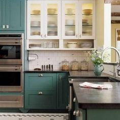 I love love love the blue/green cabinets. The contrast between the color and white is awesome! Colored Kitchen Cabinets With Tile Walls