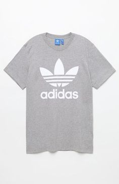 adidas does laid-back athletic style right with the Trefoil T-Shirt. This go-to tee features a classic crew neck, short sleeves, and a bold adidas Trefoil graphic on the front. Rock it with any of our jeans, shorts, or joggers for an effortlessly-cool look.    Solid tee  adidas graphic on front  Crew neck  Short sleeves  Machine washable