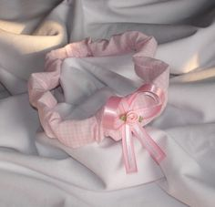 Pink Gingham Newborn Baby Girl Headband!  Every hospital needs this little baby accessory!!   All cotton fabric with elastic on the inside so it should not pull babies little hairs. Pink Satin bow with a Pink Satin Rose.   Carlykins Boutique Baby Girl Hair Bow Head by CarlykinsBoutique, $5.25