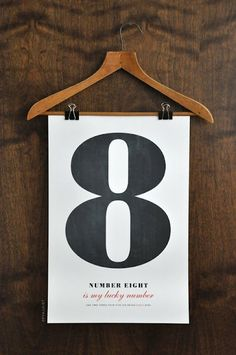 Use a hanger, a poster and two clips for an interesting apparel sign.