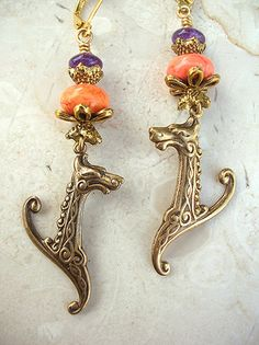 Celtic Beasties! 2 1/4 inches long light weight amethyst, magenstie & brass/alloy earrings.