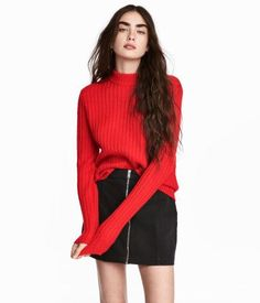 Bright red. Soft, rib-knit sweater with a small, ribbed stand-up collar and long sleeves.