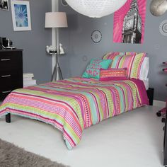 Want a bedroom set that looks like it was made by all the best crayons in the box? The OYO Pink Stipple Stripe Mini Comforter Set is not only a rainbow.