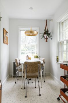 In the kitchen's cute dining nook, the Clara Dine Pendant light is made by Vita Copenhagen. The kitchen table and chairs are vintage.