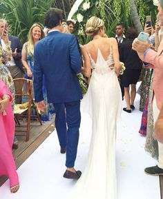 Humberto Meirelles, in Zegna, and Helena Bordon, in custom Calvin Klein, at the St. Barth's ceremony.