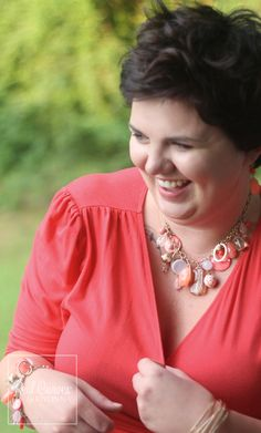 Not only do we think this shot of Katie is adorable, we also love the coral jewelry she wore with our plus size Winona Hi-Lo Wrap Dress.  #KiyonnaPlusYou  #Kiyonna  #Plussize  #MadeintheUSA