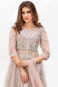 Embrace the season of festivities with this beautiful dress. Dazzle in this made to perfection, richly embroidered net outfit decorated with intricate embroidered front highlighted with silver and light golden zardozi work borders on daaman and embroidered stripes on sleeves. The bodice is fully furnished with zardozi work and sprinkled with floral motifs around neckline. […] The post Tea Pink Net Frock Sharara appeared first on Latest Pakistani Fashion 2020 - Formal Wear - Anarkali - Part Pakistani Formal Dresses, Pakistani Bridal Wear, Pakistani Dress Design, Latest Pakistani Fashion, Heavy Dresses, Sharara, Dream Dress, Fashion 2020, Formal Wear