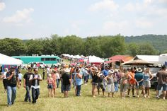 Crowds gathering to sample some of the delicious BBQ available at the 2nd Annual Chantilly Farm Bluegrass and BBQ Festival in Floyd, VA - May 2012