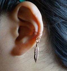 Hey, I found this really awesome Etsy listing at https://www.etsy.com/listing/201444164/double-little-bird-feather-ear-cuff