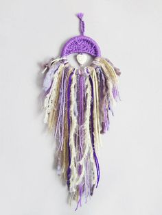 Check out this item in my Etsy shop https://www.etsy.com/listing/581591918/mini-dreamcatcer-purple-beige-hanging