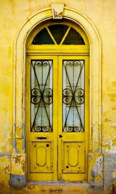 Weathered yellow doors in Mdina, Malta.