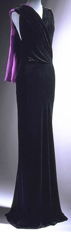 Evening dress by Madeleine Vionnet, France, 1930. Silk velvet with pink and purple chiffon streamers.