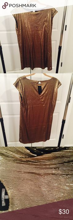 Michael Stars Gold Sequin TShirt Dress Gold sequin tshirt dress, worn once for New Years and never worn again. Fits loosely around body like an oversized tshirt. Looks great with black ankle boots Michael Stars Dresses Mini