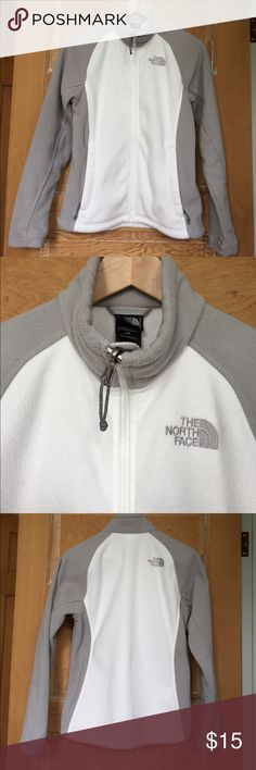 North Face Women's white and grey fleece zip up North Face Women's grey and white fleece zip up. Gently worn. Size small. In good condition- does have some pilling of the fleece (mostly on the inside of the jacket). Reflected in price and can be seen in last photos. Full length zip up with 2 pockets that zip closed North Face Jackets & Coats