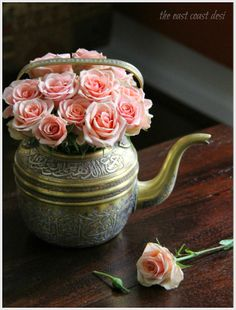 Peach Roses in an antique tea pot