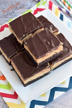 These Buckeye Brownies are amazing! Rich chocolate brownies topped with a homemade peanut butter filling and chocolate ganache.