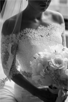 Lace overlay with 3/4 sleeves beautifully enhances the bride's gown: Real Wedding at Embassy Suites Chicago Downtown    Images by Studio Finch    #city - urban, #lace wedding dress, #bouquet
