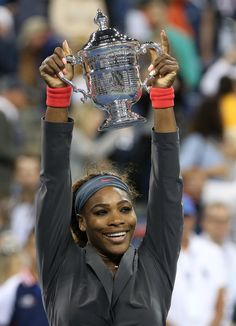 Serena Williams Photos Photos - Serena Williams of the United States is all smiles as she poses with her trophy after defeating Victoria Azarenka of Belarus in the women's final of the U.S. Open 2013 at the Billie Jean King National Tennis Center in New York City. - Serena Williams v Victoria Azarenka