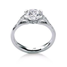 Eorsa Pavé engagement ring by MaeVona: Round brilliant-cut solitaire. Graceful, low-set ring with an open swan neck profile accented with subtle pave set diamonds. Named after the Scottish Island of Eorsa