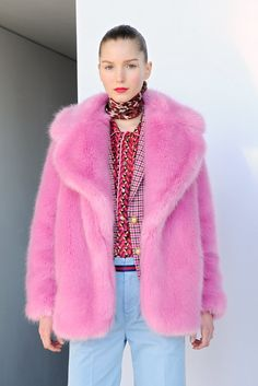 This pink faux fur coat is a statement-maker