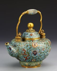 China, Cloisonne teapot, with a bright blue turquoise ground color, decorated with a dense overall pattern of auspicious motifs and symbols. Qianlong mark