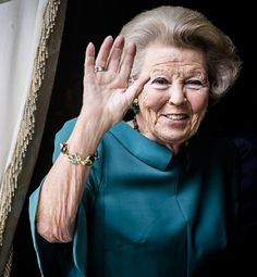 Dutch Princess Beatrix waves from the Carriage of the King during the 'Prinsjesdag' (Prince's Day) in The Hague on September 19, 2017.