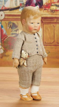 *GERMAN CHARACTER ~ type I, by: Kathe Kruse. All-cloth doll w/pressed + oil-painted facial features, jointed arms, separately-stitched thumb, disc-jointed, Marks: Kathe Kruse 1131 Germany (feet). Comments: Kathe Kruse, Type I, c.1915, realized price: $4,800