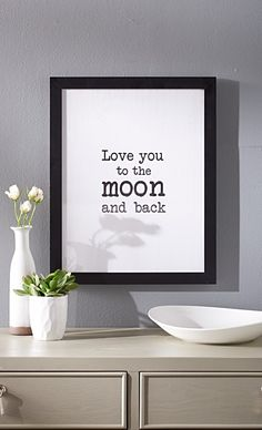 "Our ""Love You to the Moon and Back"" Wall Art stretches affection to intergalactic levels. Like a love note keyed on an old-school typewriter, this sweet sentiment should be displayed for your sweetheart - or entire family - to see as they pass by each day, inspiring warm, fuzzy feelings all around."