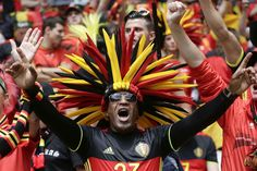 A Belgium team's fan cheers as he waits for the start of the Euro 2016 Group E soccer match between Belgium and Ireland at the Nouveau Stade in Bordeaux, France, Saturday, June 18, 2016. (AP Photo/Petr David Josek)/FP105/666005007946/1606181441