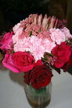 NSE creation - pink ombre with protea center bouquet.