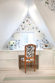 "Schumacher's ""Birds and Butterfies"" wallpaper adds a touch of whimsy to this attic workspace."