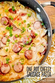 One Pot Cheesy Smoked Sausage and Pasta Skillet - A 20 minutes meal that cooks all in one pot for less mess and goes quickly from stove to table!.