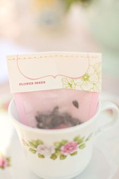 In a teacup - flower seeds favor, or can be tea leaves, etc ...