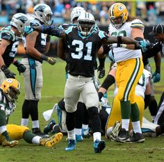 fd85621b0 Carolina Panthers cornerback Charles Tillman celebrates a defensive stop vs  the Green Bay Packers during second