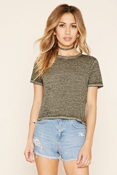 A semi-sheer tee crafted from a super-soft burnout knit with a ribbed crew neckline, a boxy fit, and short sleeves.